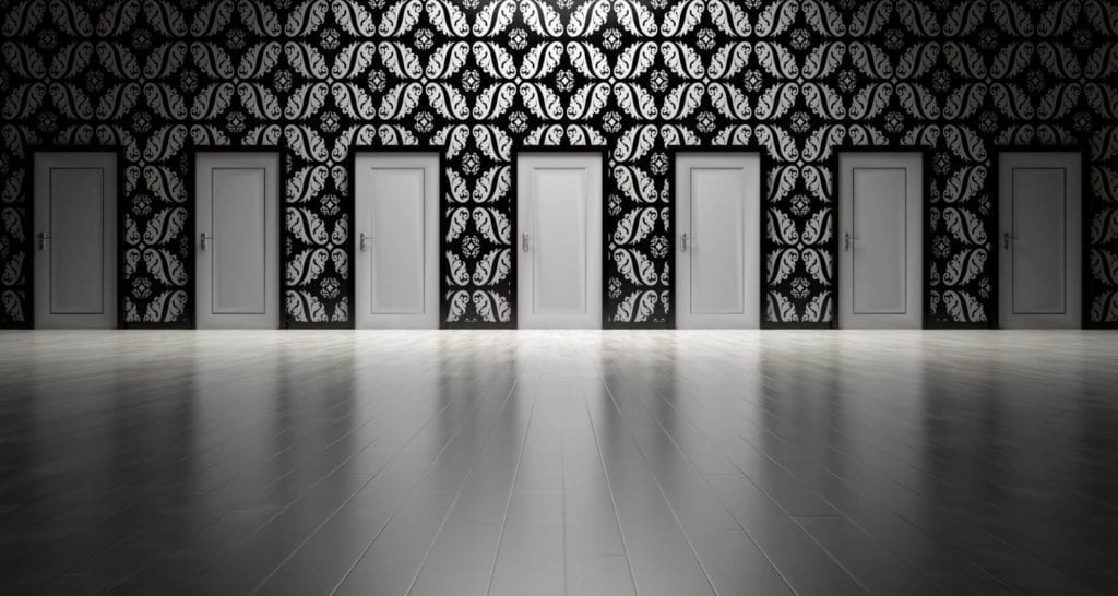7 doors in a hallway to choose from