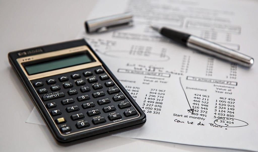 Calculator and pen resting on HRLocker document