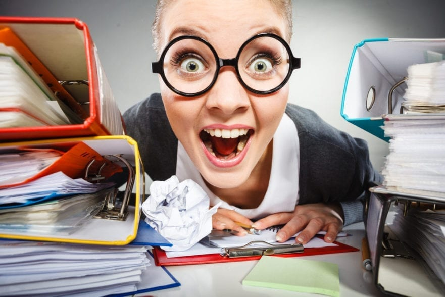 image of insane office woman for blog post about timesheets