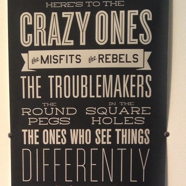 Sign with a quote saying heres to the crazy ones, the misfits and the rebels