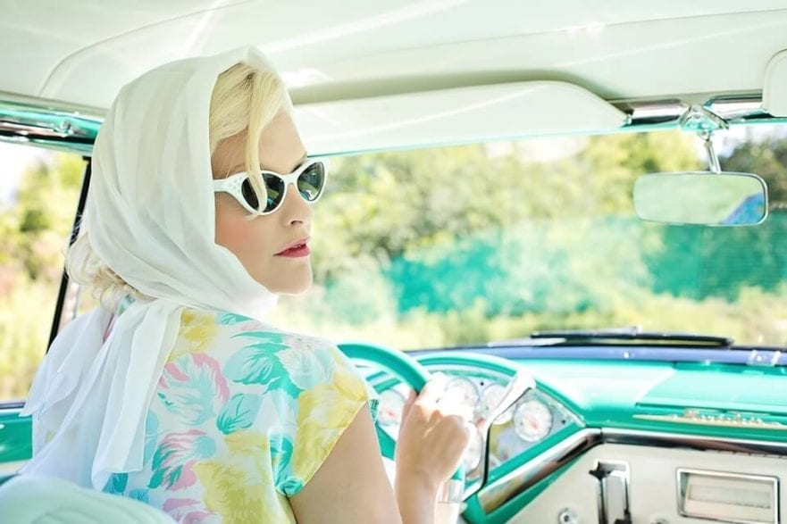 pic of lady driving a vintage car for blog post about legal obligations of employers for staff that drive for work