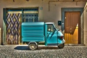 Small blue 3 wheel vehicle