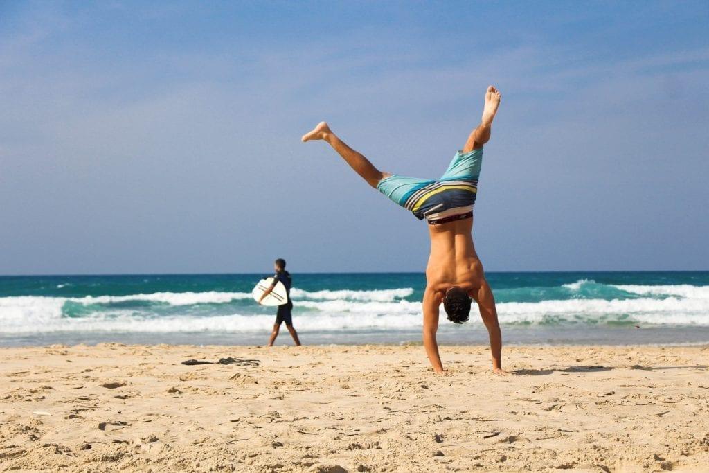 Man cartwheeling on the beach