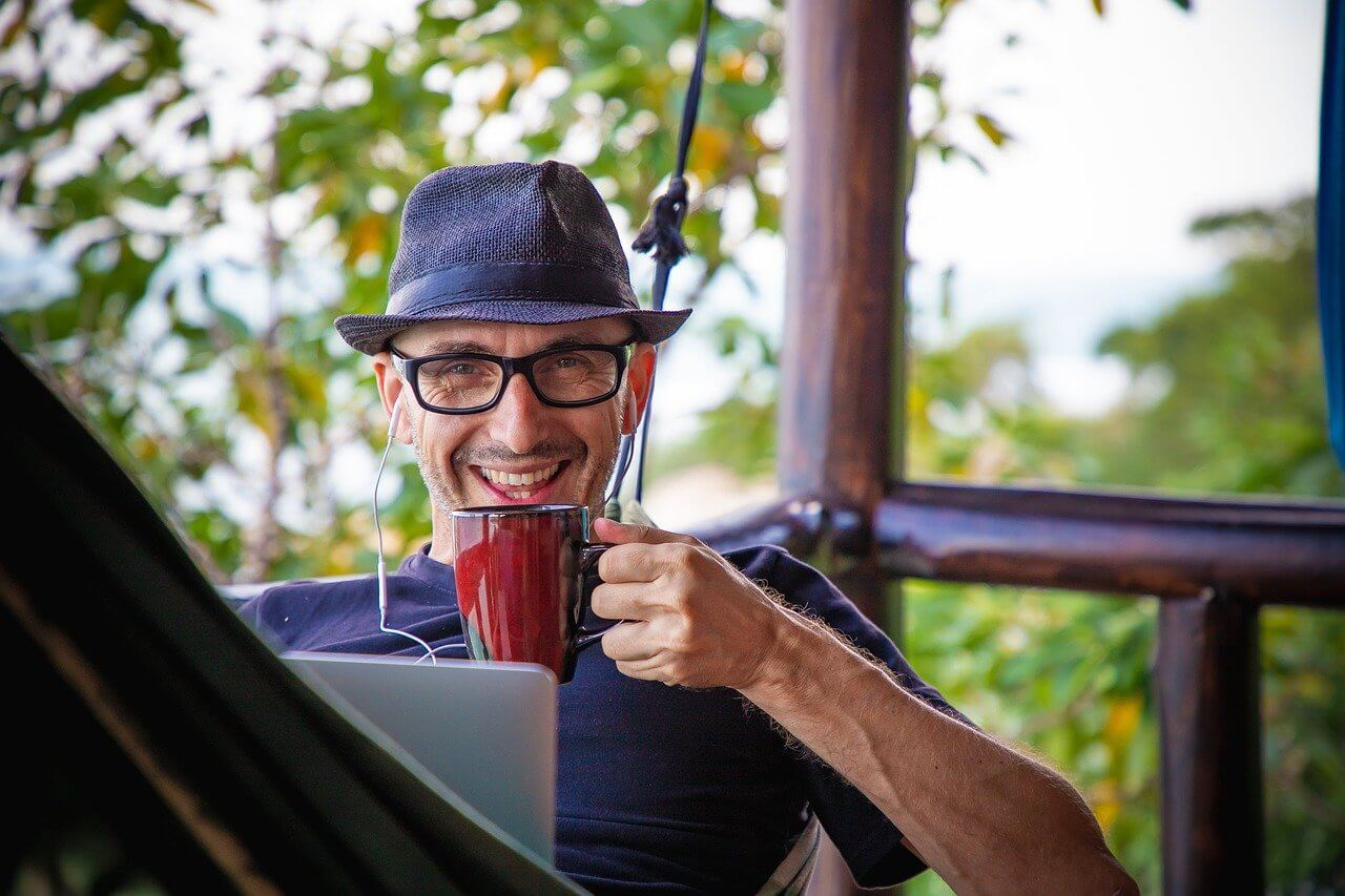 Man drinking coffee while working from home